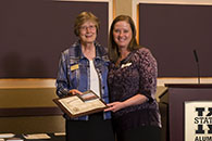Karolyn Barclay, right, accepts the 2014 Kansas State University Global Campus Extraordinary Student Award from Sue Maes, dean of Kansas State University Global Campus.