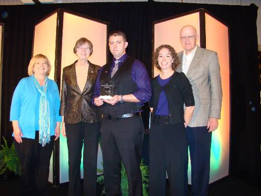 Michael Feingold, center, accepts his award at the University Professional and Continuing Education Association's national conference. With Feingold were Kansas State University Global Campus staff members, from left: Debbie Hagenmaier, Sue Maes, Marci Ritter and David Stewart.